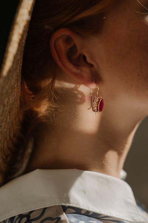 Woman Wearing Silver Diamond Stud Earring