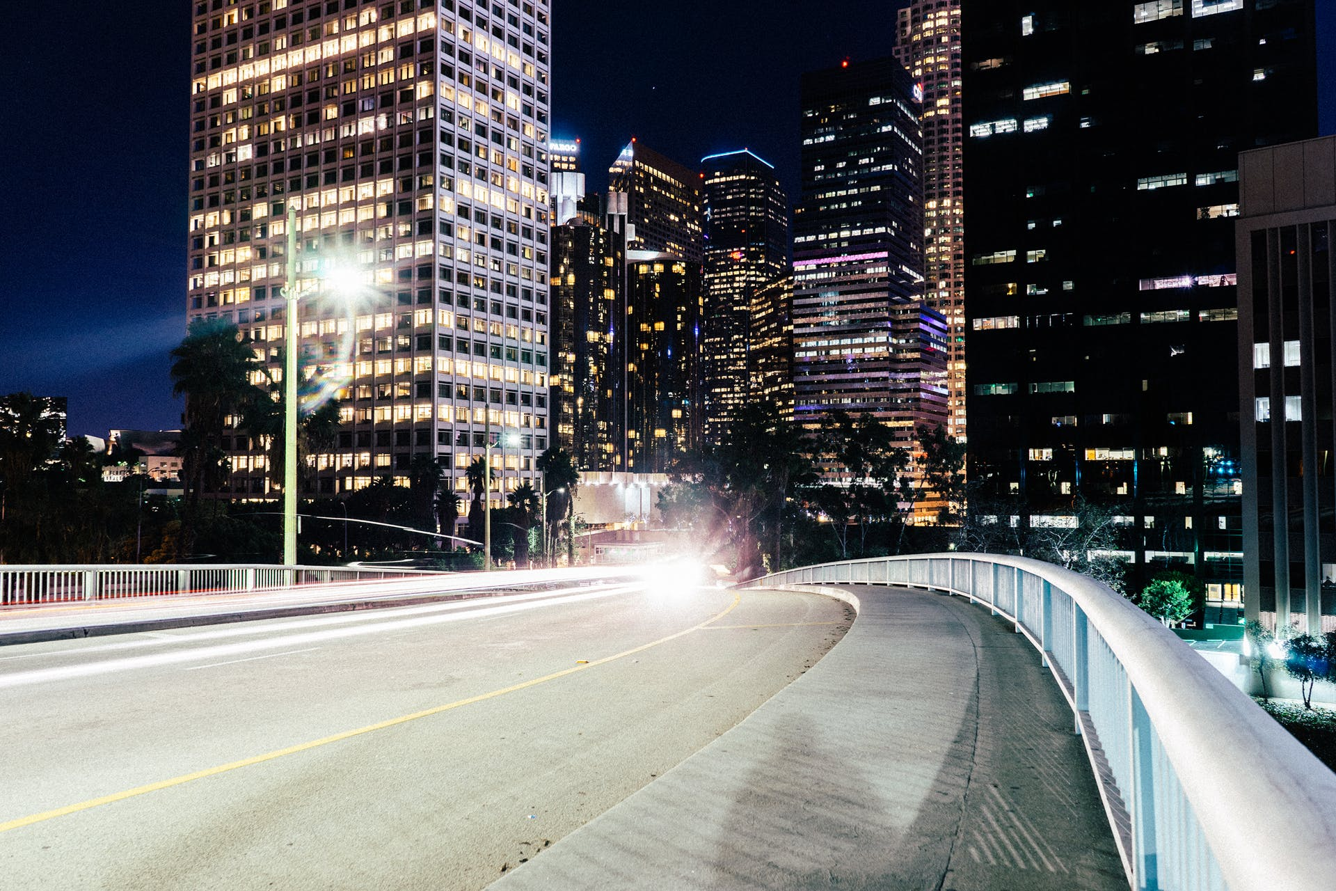Time-lapse Photography of Bridge Near Buildings at Night