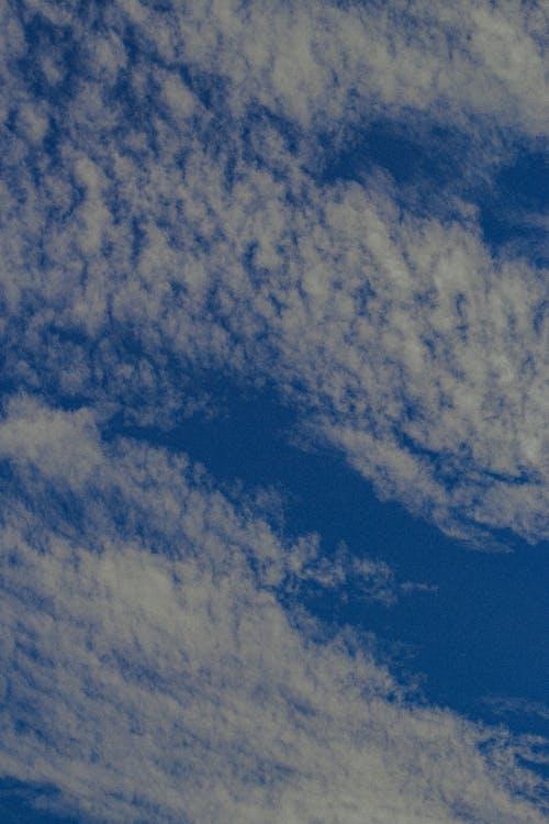 Cirrus clouds high in sky