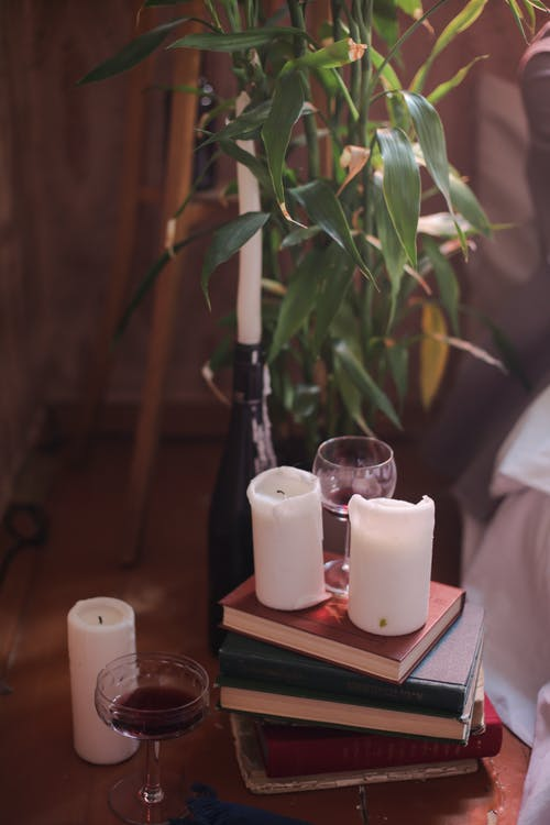 3 White Pillar Candles on Brown Wooden Tray