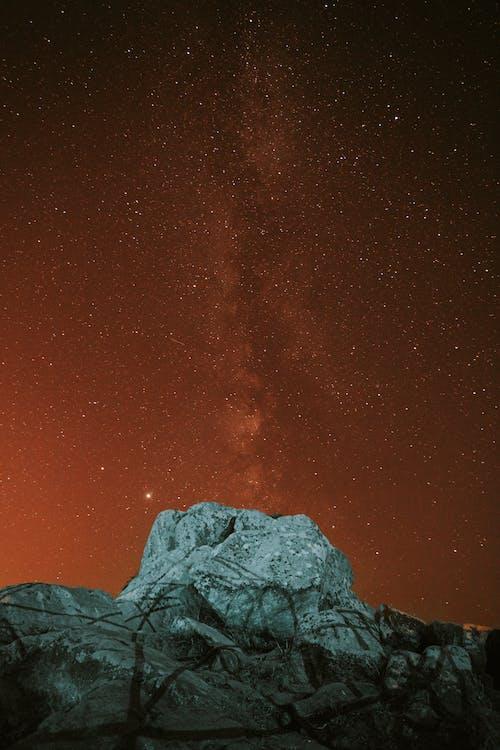 Starry sky over mountainous terrain