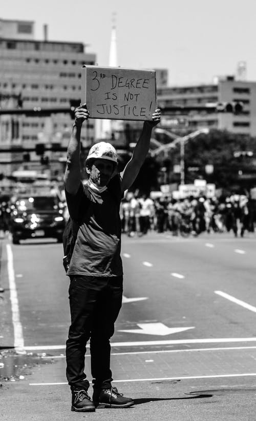Man on road with protest sign