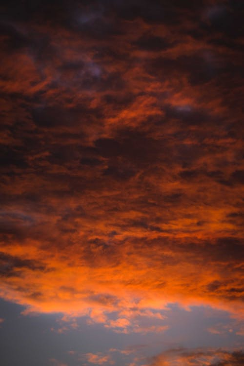 Thick clouds floating in bright sunset sky