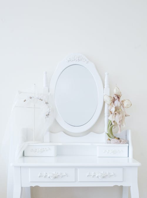 White Ceramic Toilet Bowl on White Wooden Table