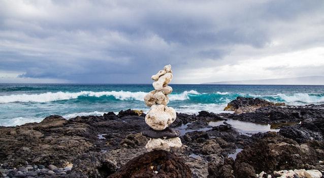 White Stone Balancing on Beach Shore