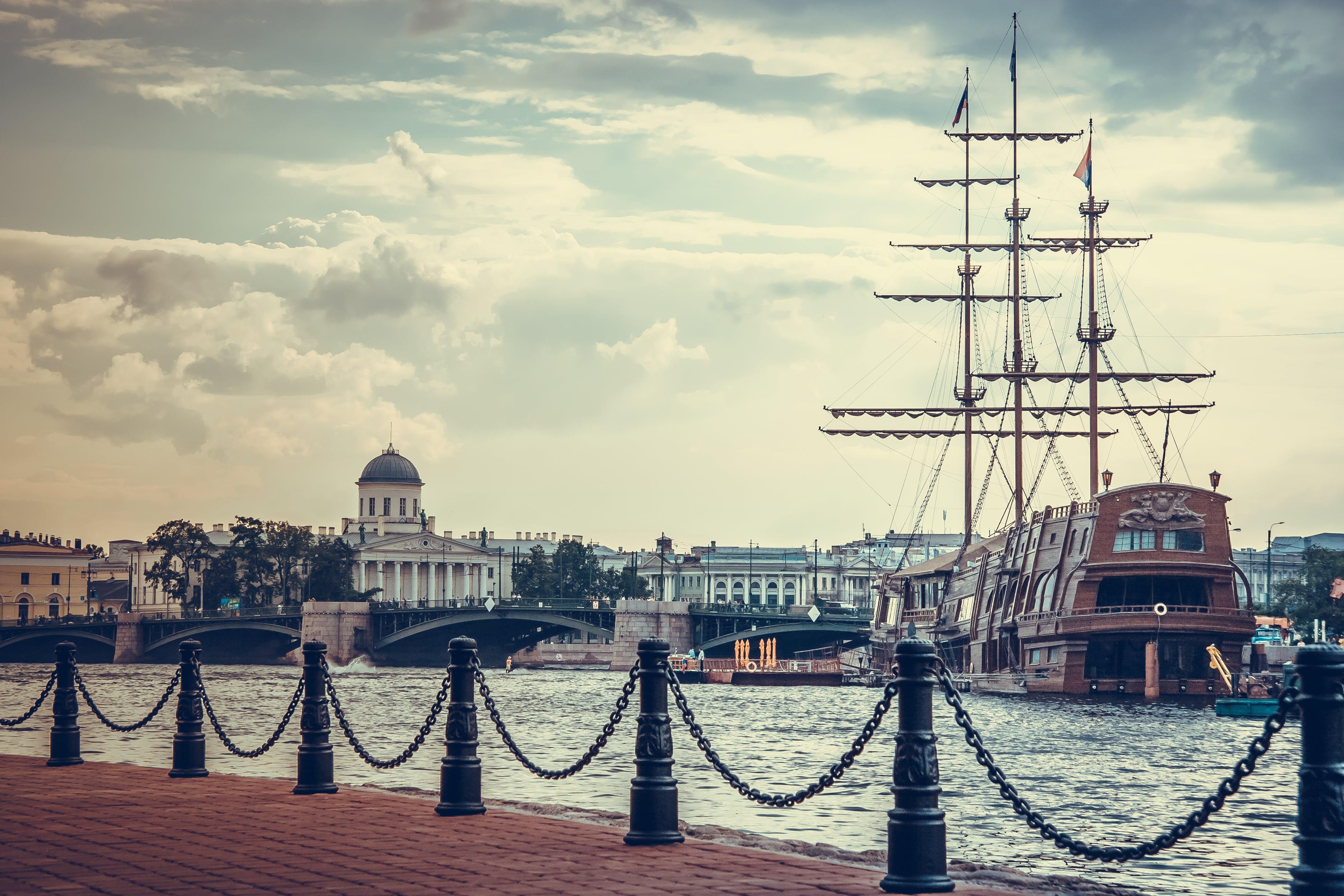 Brown Ship Beside Dock