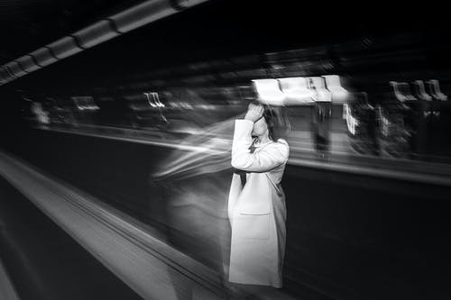 Faceless woman waiting for metro cabin in subway