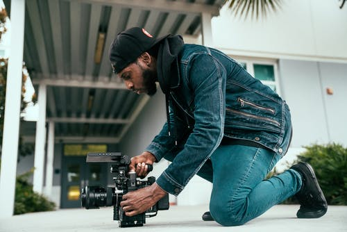 Camera Man Making Adjustments to his Camera
