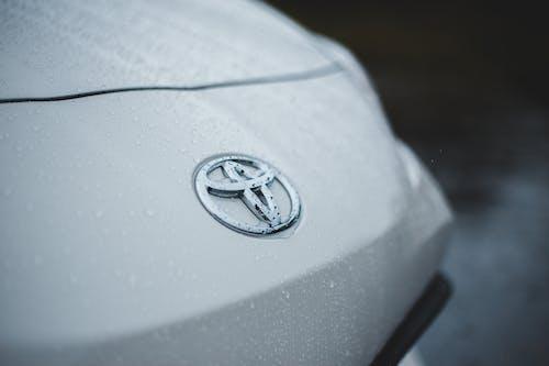 Shiny car with drops of rain