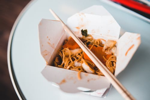 Appetizing noodles with sauce in box