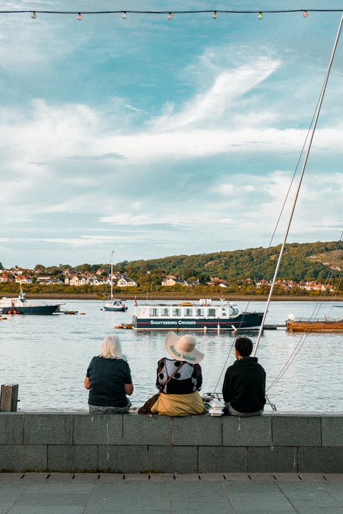People sitting on quay at daytime