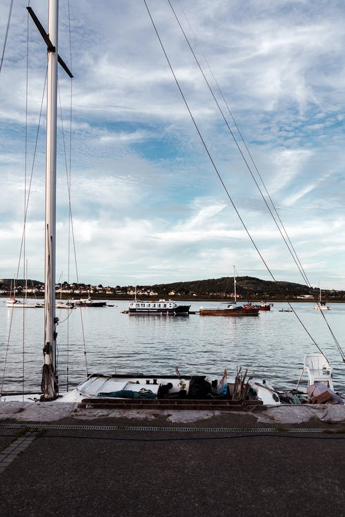 Sailboat standing on water near berth