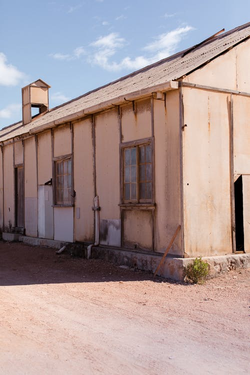 Shabby house on dry terrain