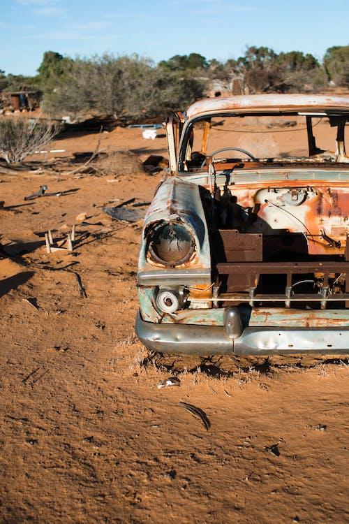 Rusty car abandoned in desert
