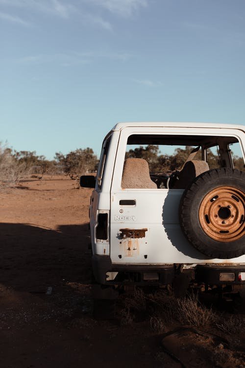 Old auto located in dry terrain