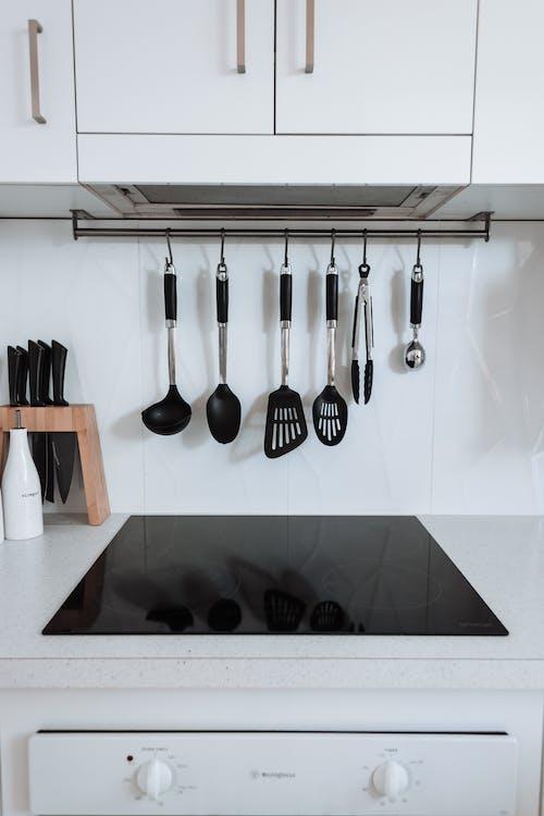 Interior of light kitchen with kitchenware