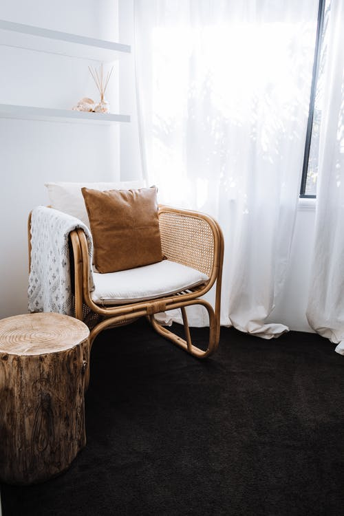 Interior of light room with armchair and wooden elements