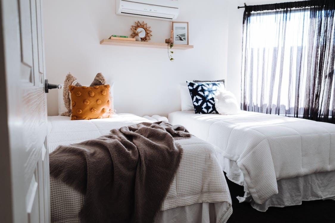 Separate beds in bedroom in sunlight