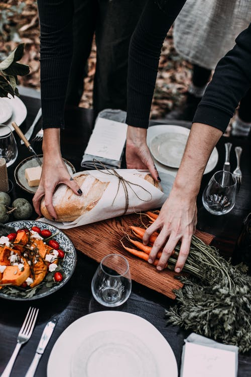 Woman putting bread on cutting board for picnic