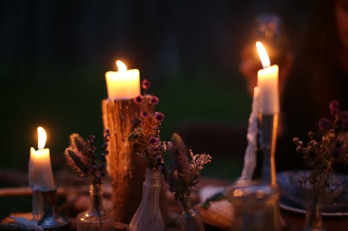Burning candles on festive table in evening time