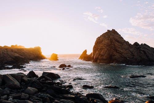 Rocky coast of sea at sundown