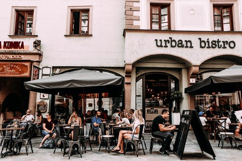 Street cafe with people and tables