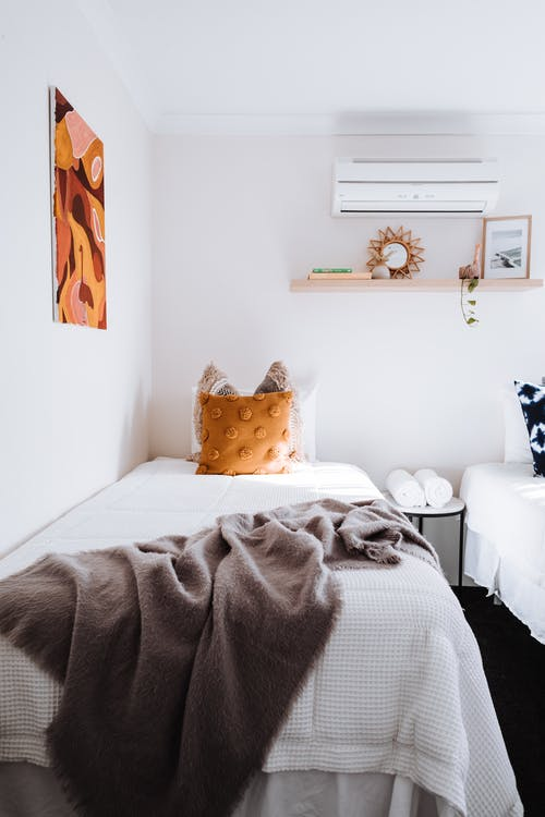 Light bedroom with cushions on bed