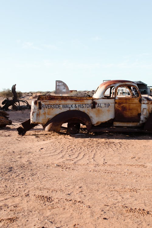 Old rusty car in desert land