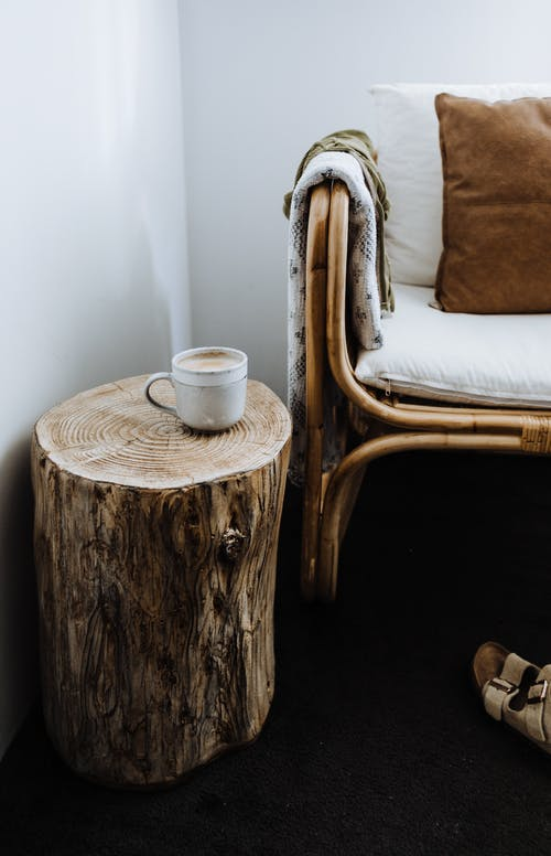 Chair placed near wooden stump in apartment