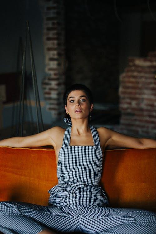 Stylish confident woman sitting on sofa