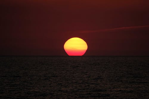 Scenic vivid sunset over rippling ocean