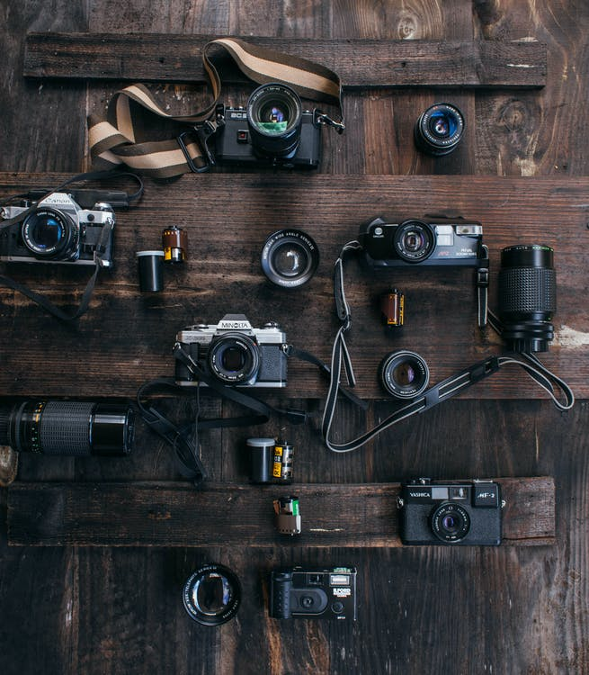 Collection of vintage cameras on surface
