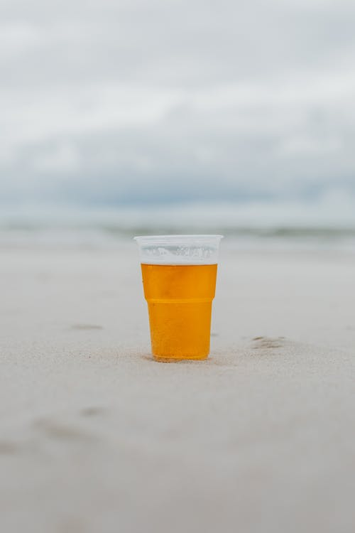Glass of Beer on the Sand