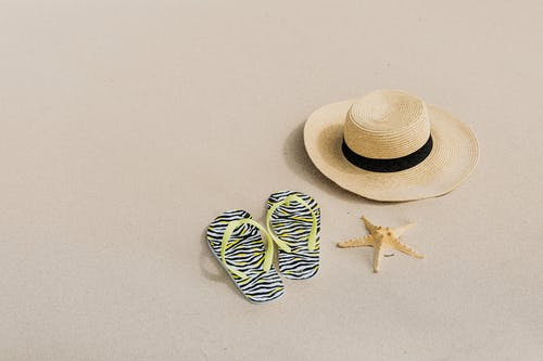 Brown Straw Hat on White Surface