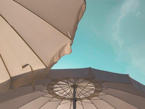 Big umbrellas against blue sky