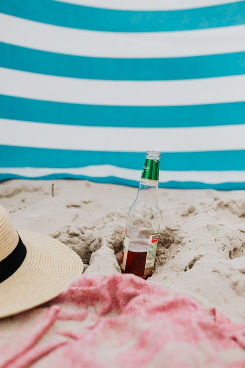 A Bottle of Beer on the Sand