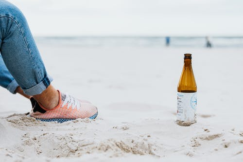 Beer Bottle in the Sand