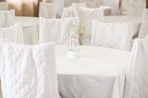 Clear Glass Vase on White Table Cloth
