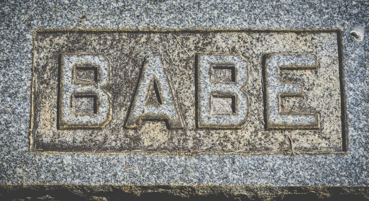Inscription babe on gray stone block