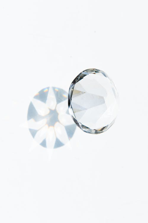 Diamond On White Surface