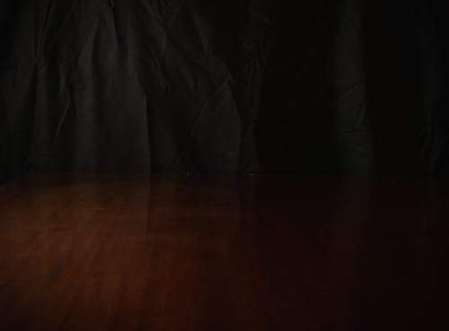 Black Textile on Brown Wooden Table