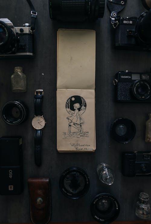 Black Camera Beside Black Round Analog Watch