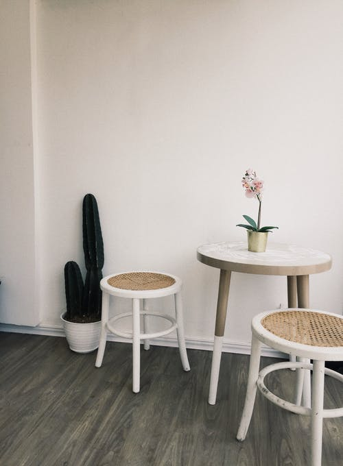 Brown Wooden Round Table With White Chairs