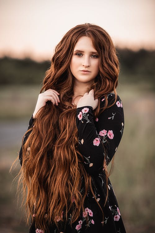 Young woman with long hair in park