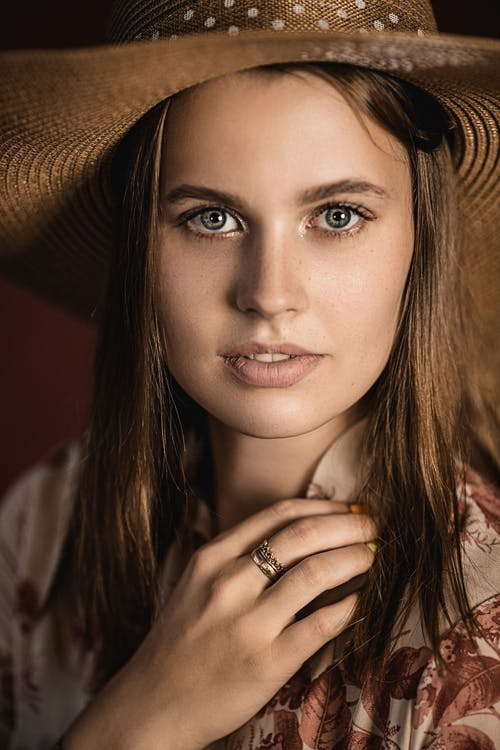 Attractive woman in straw hat in studio