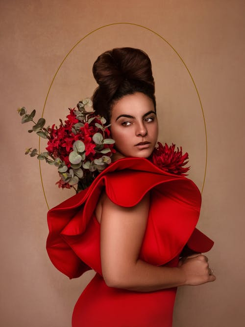 Woman in Red Dress Holding Red Rose