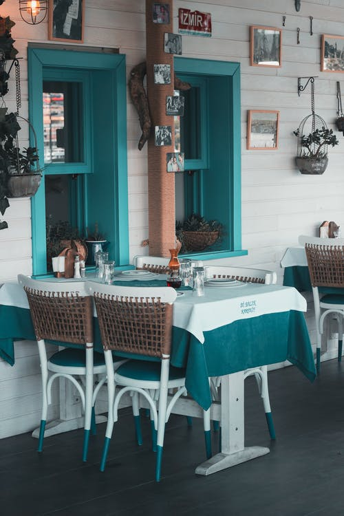 White and Green Table Cloth With Chairs