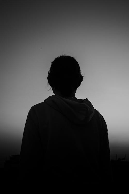 Silhouette of Man in Hoodie