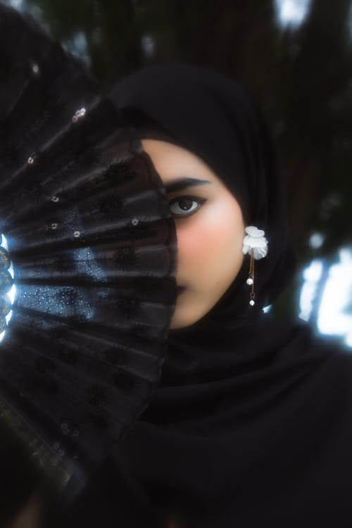 Woman in Black Hijab With Silver Ring