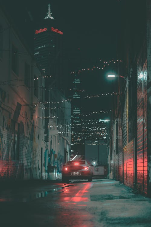 Red Car on Road during Night Time